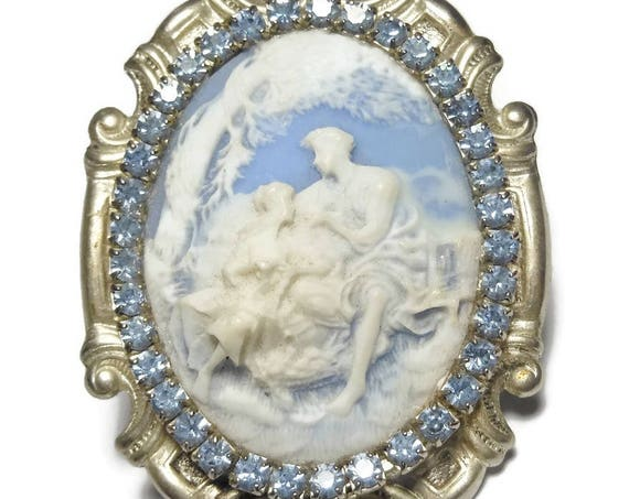 Large cameo brooch, beautiful carved cream on blue lovers couple scene rhinestone edge, oval silver ornate frame dimensional