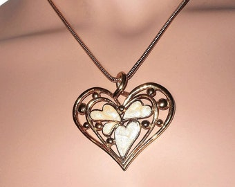 Mother of pearl pendant necklace, gold snake chain, openwork heart pendant with mother of pearl heart inserts
