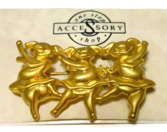 Danecraft dancing pigs brooch pin, burnished gold dancing pigs in tutus, three pigs doing ballet, gold plated on original card