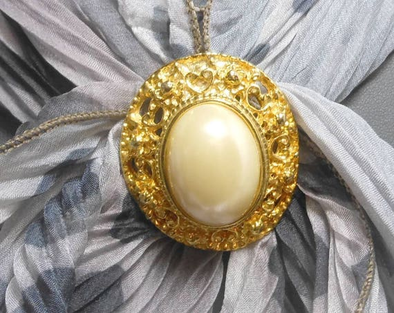 Gold scarf clip ring, oval faux pearl cabochon, gold tone open work frame,  scarf slide, sweater clip, vintage