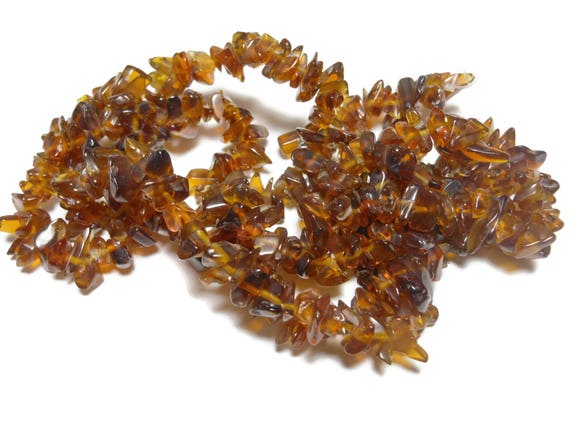 Brown glass bead, large chip. Sold per 34-inch strand, brown spacer beads