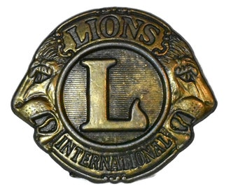 Lions belt buckle, bronze fraternity buckle, monogram L, two lion profiles, Lions International engraved on top  and bottom, marked 4076