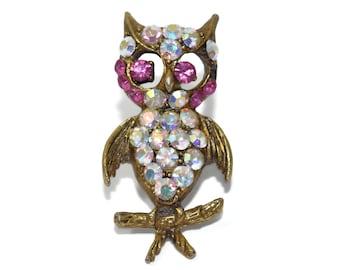 AB rhinestone owl Aurora Borealis pave clear rhinestone owl on branch with pink rhinestone eyes and highlights