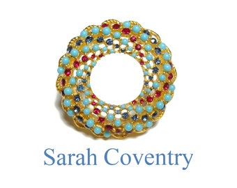 Sarah Coventry circle pin, 'Song of India' 1965, red blue rhinestones, turquoise colored beads, wreath brooch, gold plated no missing beads
