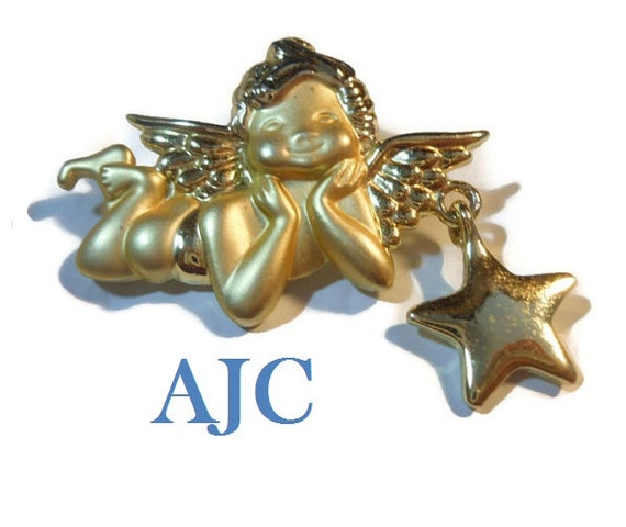 AJC cherub brooch, signed gold tone cherub brooch pin with star charm, matte and shiny finish