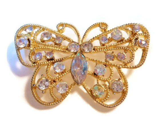 Butterfly brooch, open work rhinestone AB butterfly (Aurora Borealis) in gold tone
