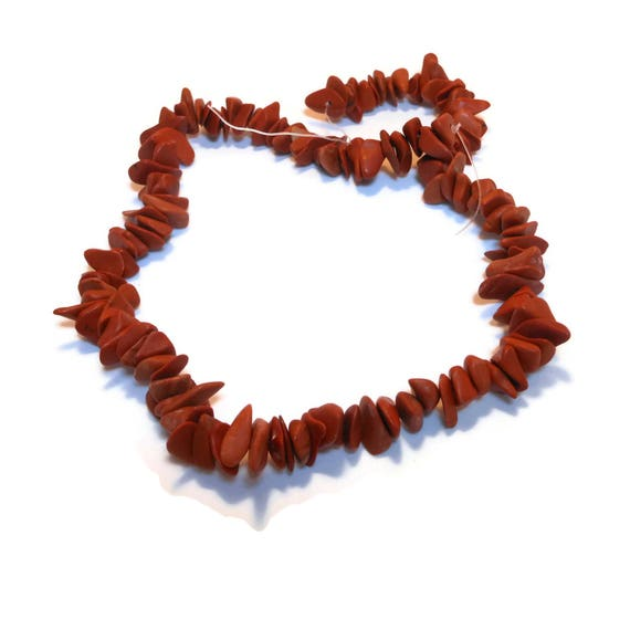 Bead, red jasper (natural), large chip, sold per 15-inch strand, chips range from medium to extra-large with an average size of large