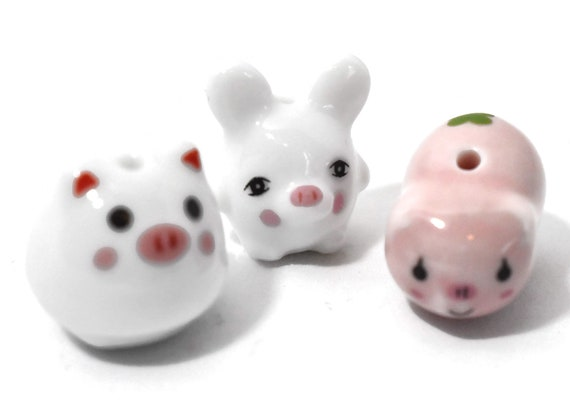Porcelain pig beads, 3 piece lot, ceramic Kawaii, one pink with shamrock, 2 different white
