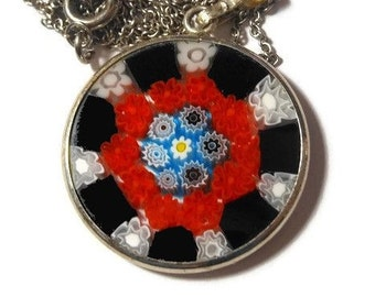 Millefiori glass pendant, 25mm round red, black, blue, yellow white disc on sterling silver chain marked 925 Italy on bail