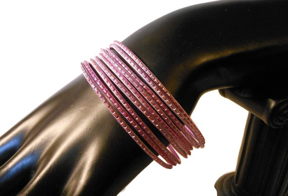 Pink etched bangle bracelets, set of eight stacking bangles, notched design