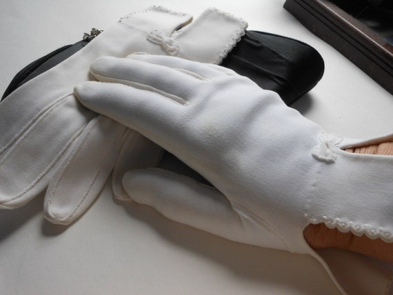 Van Raalte gloves white unusual uncut salesmen samples or straight from factory floor, bow and scalloped edges.