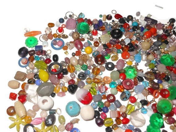 Mixed lot beads and findings, 12 ounces glass wood plastic ceramic, some gemstones, findings include clasps, bead caps jump rings and more
