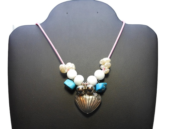 Heart necklace, silver tone heart charm and beads, white cats eye beads, turquoise chips and faux pearls on pink cording