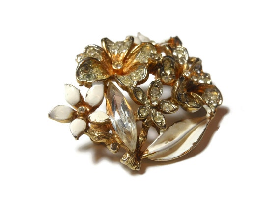 Capri floral brooch, pave rhinestones, navette rhinestones and white enamel petals in a coppery gold tone setting, great wedding piece
