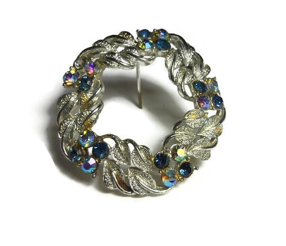 Rhinestone circle pin brooch with silver leaves, late 1950s early 60s, blue rhinestones and Aurora Borealis (AB) rhinestones