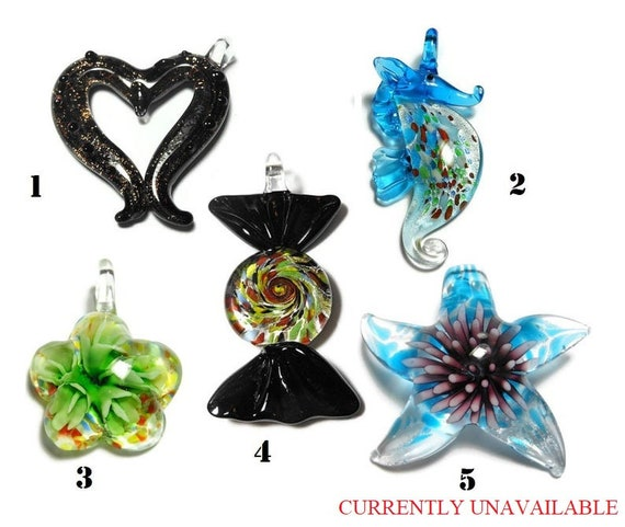 Figural lampwork pendants, black and gold glitter bumpy heart, green swirl candy, blue seahorse, green flower and purple and blue starfish