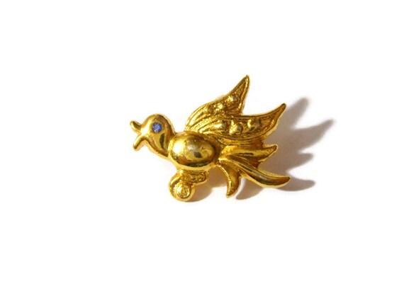 Cute little gold tone bird brooch with blue rhinestone eyes