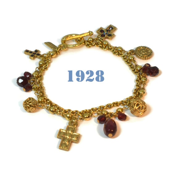 1928 charm bracelet, gold two strand, plain curb chain, rolo bead chain with charms, Ruby red glass drops, marcasite and rhinestone crosses