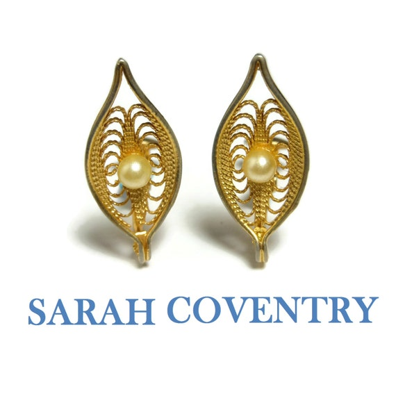 "Sarah Coventry earrings, ""Serene"" 1969 clips, filigree leaf, faux pearl, gold plated"