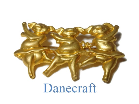 Danecraft dancing pigs brooch pin, burnished gold dancing pigs in tutus, three pigs doing ballet, gold plated