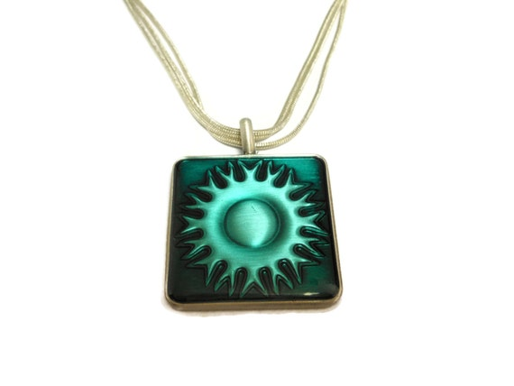 Southwest sun pendant, blue green square, epoxy sun in a pewter frame, silver plated chain, three strand, decorative clasp