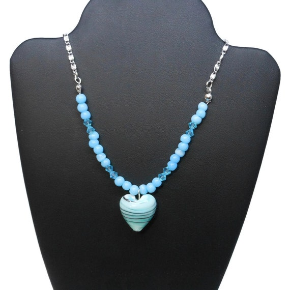 Lampwork heart necklace, blue heart with striped swirls of black & white, blue Swarovski crystals, cats eye glass, silver plated chain
