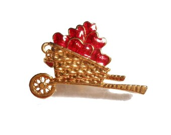 Red hearts cart brooch Avon red hearts in gold tone cart brooch pin with little red charm 1992