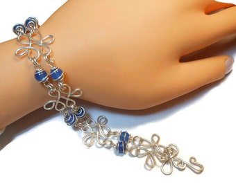 Sterling silver filigree bracelet with blue agate caged beads all handmade with hammered filigree components, handmade
