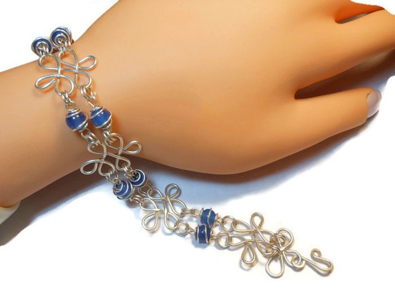 Sterling silver filigree bracelet with blue agate caged beads all handmade with hammered filigree components