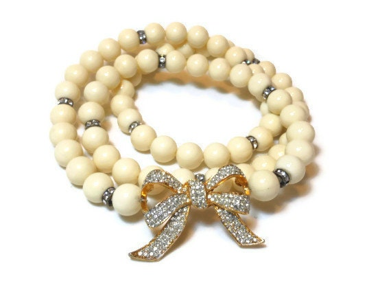 Faux pearl necklace, creamy faux pearls with rhinestone spacer accents and bow long necklace