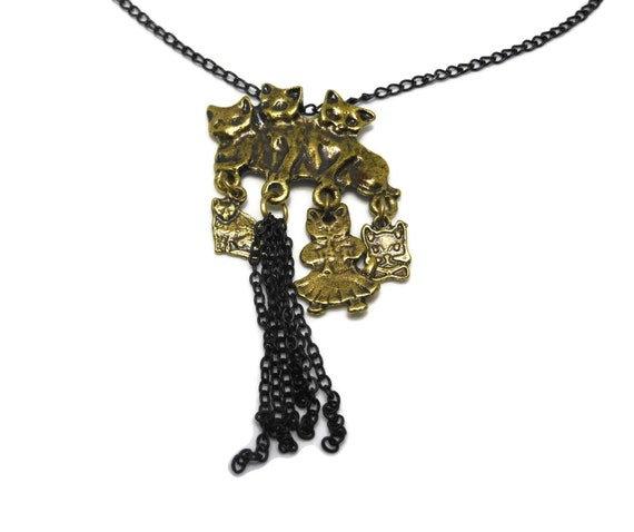 Antiqued brass cats necklace, whimsical 3 kittens playing with 3 'toy' kittens, black chain, black dangles, extender leaf end