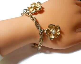 Marvella charm bracelet, floral pearl bracelet, brushed gold petals interior pearl center, rope chain link, designer signed vintage
