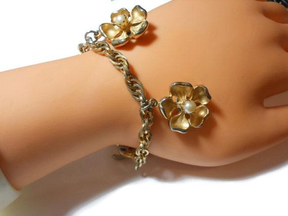 Marvella charm bracelet, floral pearl bracelet, brushed gold petals interior pearl center, chain link, designer signed vintage