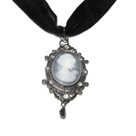 Gunmetal cameo choker, white cameo on grey background, ornate frame with rhinestones, black velvet choker, gunmetal extension.