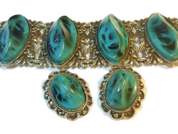 Large faux turquoise thermoset, four panel bracelet and clip earrings Southwest style