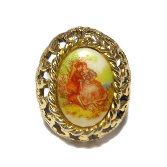 Fragonard Transferware adjustable ring, hand painted couple, idyllic setting oval ceramic cabochon inside gold ornate frame, gold plated