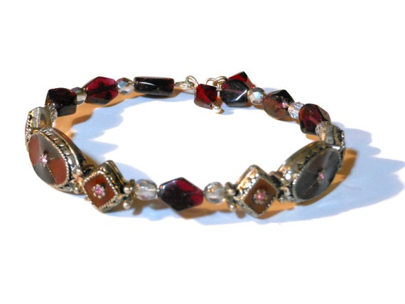 Garnet gemstone bracelet, garnet and Czech mirror beads flank two vintage enamel sets, ending with garnet colored Swarovski crystal charms