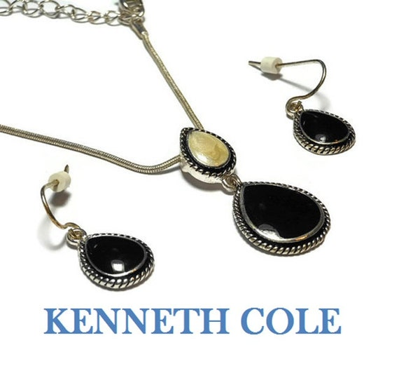 Kenneth Cole necklace and earrings, black teardrop framed by a knot pattern, white swirled enamel glitter reverse teardrop too