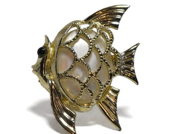 MOP fish brooch, gold angel fish with open work over mother or pearl cabochon with a green glass cabochon eye