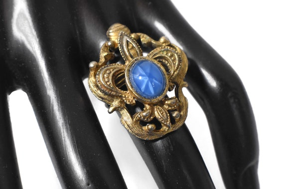 French fleur de lis ring, ornate design,  faux blue star sapphire, adjustable, looks like a frog!
