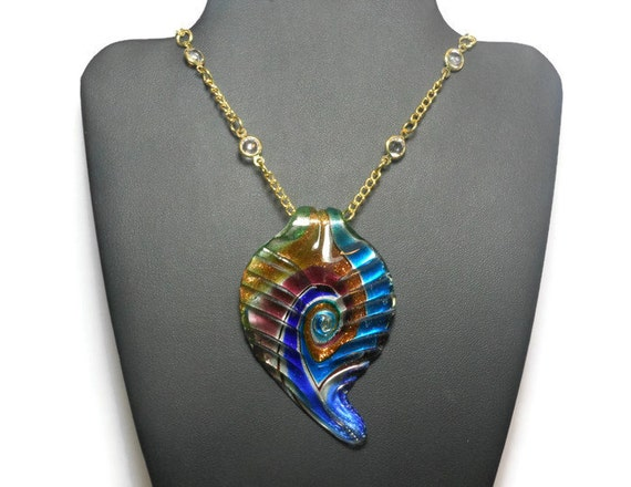 Lampwork crystal necklace, large lampwork leaf in swirling blues, greens and gold sparkle foil on a gold plated chain with clear crystals.
