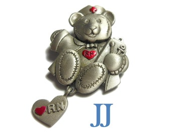 Pewter nurse bear brooch, teddy as nurse, heart charm red enamel heart and RN on it, hat has red cross and red heart on chest