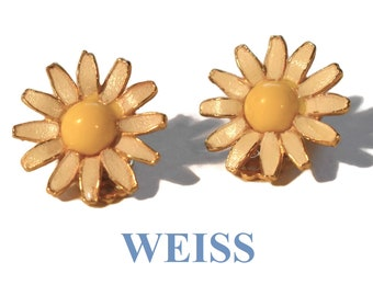 Weiss daisy earrings, 1940s 1950s, clip-on white petals with yellow center, marked Weiss no copyright sign