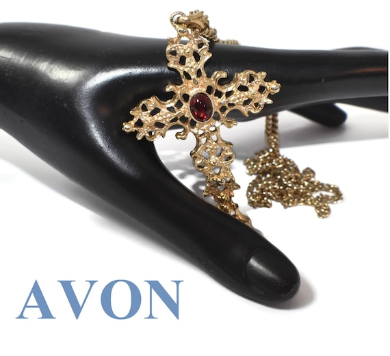 Avon Abbey 1975 cross pendant, Gothic filigree cross with a ruby-colored oval cabochon
