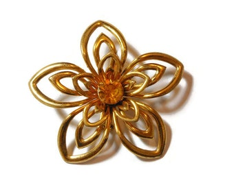 1940s Coro brooch, gold open work petals on this floral brooch with amber rhinestone faceted center, statement piece