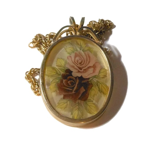 Roses pendant, reverse paint on glass pink and wine red roses with silvery white background on oval gold frame, wheat chain