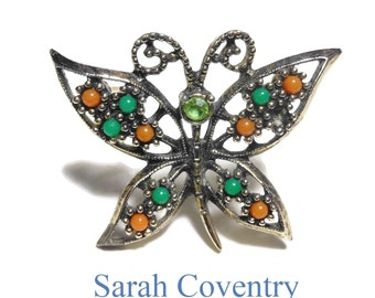 Sarah Coventry butterfly brooch, open work pin, rhinestone head, glass cabochon beads wing, gold tone, green orange, 'Wings of Fashion' 1974