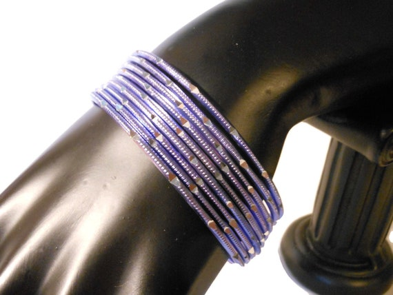 Blue etched bangle bracelets, set of nine stacking bangles, notched design, blue with silver glimmers