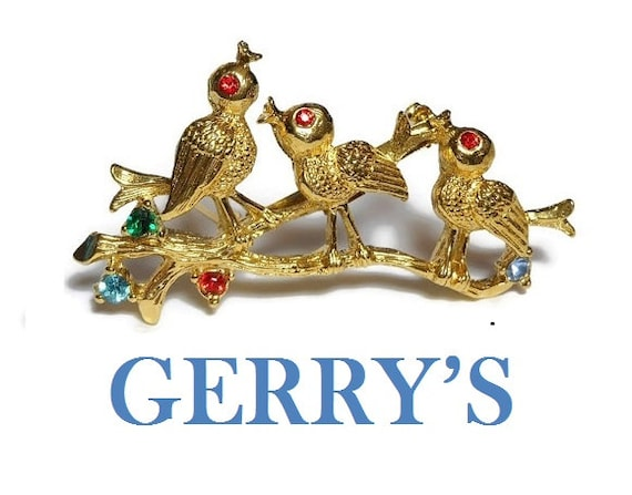 Gerry's birds brooch, gold pin birds on a log, red rhinestone eyes, red green blue rhinestone flowers, figural floral brooch