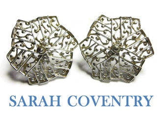 Sarah Coventry clip earrings, 1961 Lady of Spain collection, lacy filigree open work, silver tone snowflake pinwheel statement